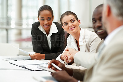 Buy stock photo Beautiful young business woman shaking hands with her senior
