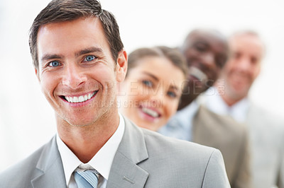 Buy stock photo Closeup portrait of a positive business man with his coworkers at the back