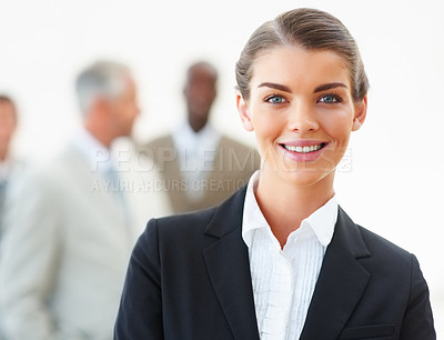 Buy stock photo Portrait of a beautiful young business woman with colleagues at the background