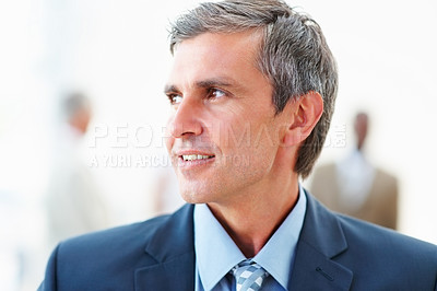 Buy stock photo Portrait of a successful mature business man looking away