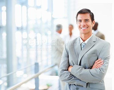 Buy stock photo Portrait of a confident business man with hands folded