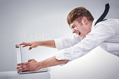 Buy stock photo Shot of a screaming man being blown away by the screen of his computer -CGI