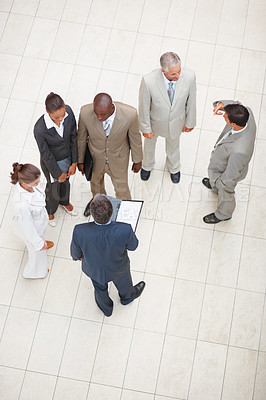Buy stock photo Top view of a group of business people standing together