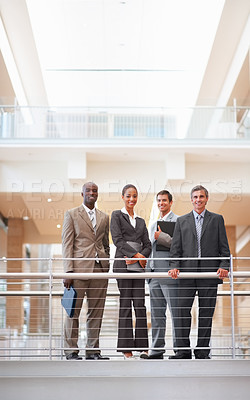 Buy stock photo Professional cheerful business colleagues standing by a railing