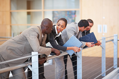 Buy stock photo Portrait of confident business colleagues resting on a glass railing