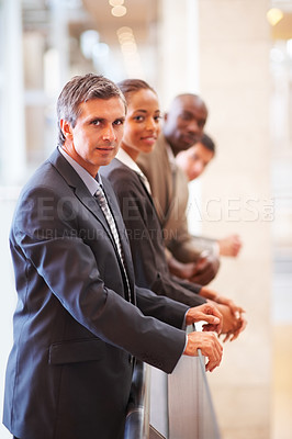 Buy stock photo Portrait of successful business colleagues by a railing