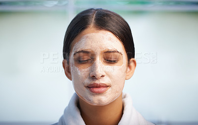 Buy stock photo An attractive young woman wearing a facial mask