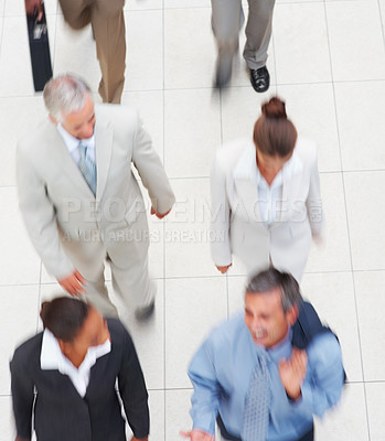 Buy stock photo Top view of a group of business people, walking