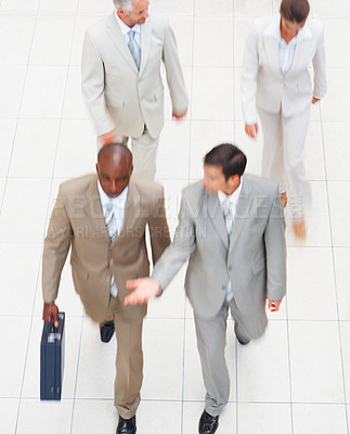 Buy stock photo Blur image of successful business people hurrying to the office