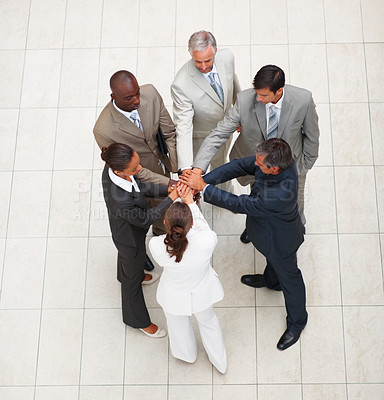 Buy stock photo Top view of a team of business people with their hands together in unity