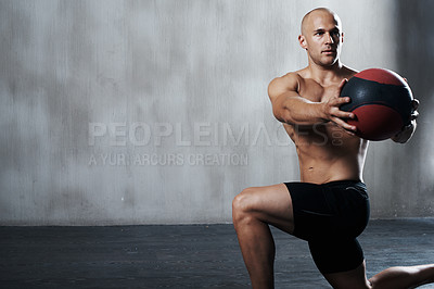 Buy stock photo Shot of a man working out with a medicine ball at the gym
