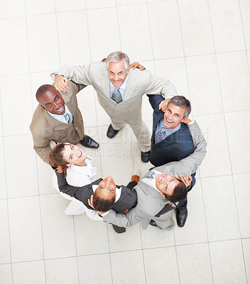 Buy stock photo Portrait of successful positive business people forming a huddle and looking upwards