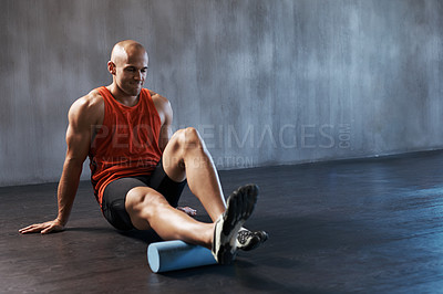 Buy stock photo Shot of a handsome young man working out in the gym