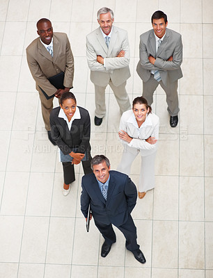 Buy stock photo Group of professional business people looking above and smiling