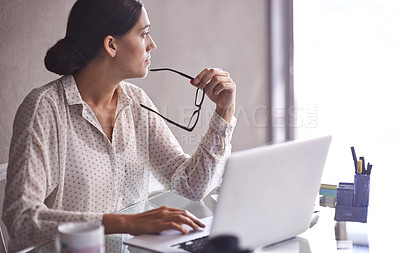 Buy stock photo Shot of a beautiful young business woman thinking at her desk