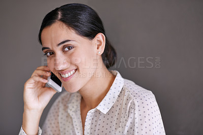 Buy stock photo Portrait of a beautiful young businesswoman using a cellphone