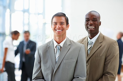 Buy stock photo Portrait of two business colleagues enjoying at their workplace