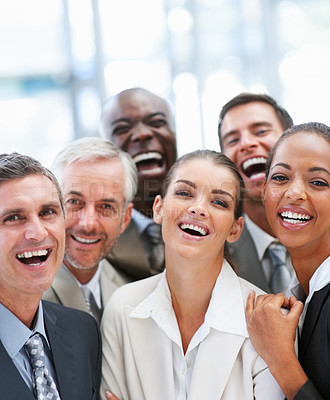 Buy stock photo Group of business colleagues laughing together