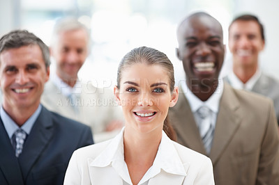 Buy stock photo Portrait of a cute business woman with team at the back