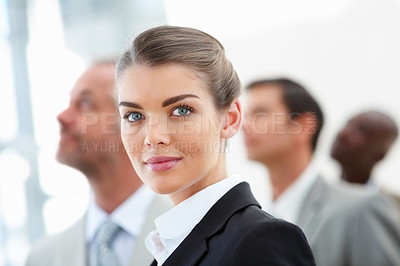 Buy stock photo Closeup of a cute young business woman with colleagues at her back