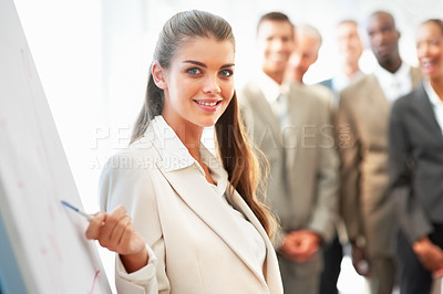 Buy stock photo Beautiful young business woman lecturing a team of colleagues