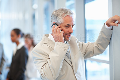 Buy stock photo Portrait of an old business man speaking on a mobile