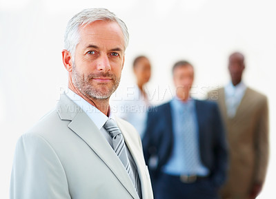 Buy stock photo Mature business man with team at the back on white background