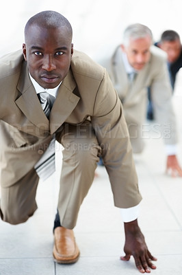 Buy stock photo African American business man ready to compete against colleagues