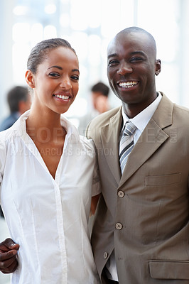 Buy stock photo An African American business man and woman posing together and smiling