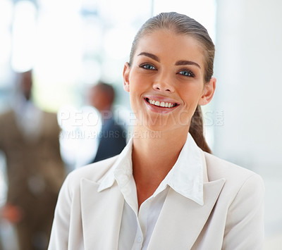 Buy stock photo Image of a confident smiling business woman with people at the back