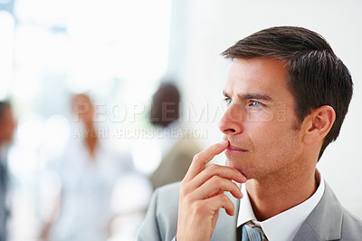 Buy stock photo Portrait of a good looking business man in a contemplative mood