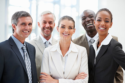 Buy stock photo Cheerful team of business people standing in a group together