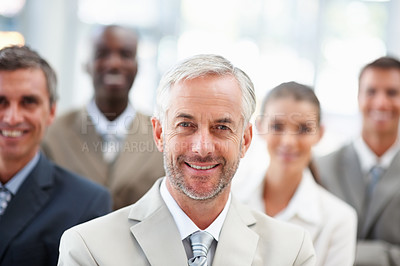 Buy stock photo Confident business man with team at the back