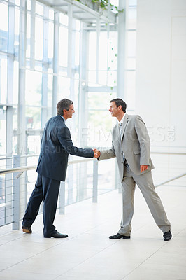 Buy stock photo Full length image of successful business men shaking their hands