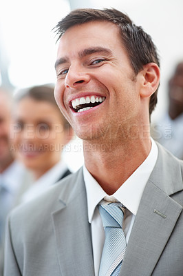 Buy stock photo Portrait of a handsome delighted business man in grey suit