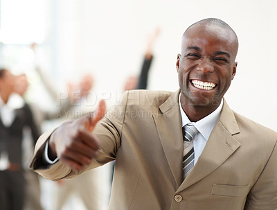 Buy stock photo Cheerful African American business man, laughing while giving you a thumbs up - copyspace