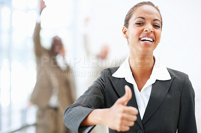 Buy stock photo Portrait of a pretty African American business woman showing a thumbs up sign
