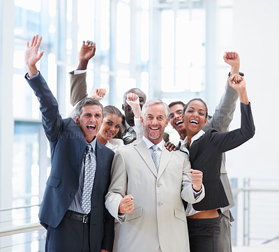 Buy stock photo A professional group of business people smiling with their hands raised
