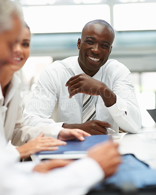 Buy stock photo Happy young African American man at a business meeting