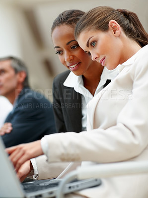 Buy stock photo Happy young business women working on a laptop
