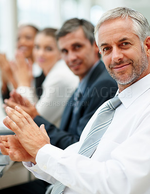 Buy stock photo Portrait of successful business team applauding at a conference