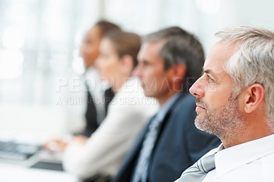 Buy stock photo Successful business man at a business seminar