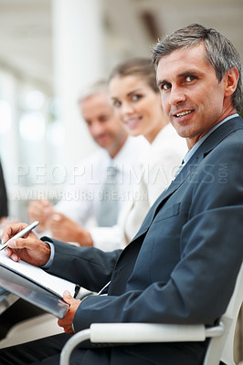 Buy stock photo Mature business man sitting with a team of colleagues