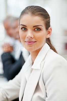 Buy stock photo Portrait of a lovely smiling business woman with people in the background
