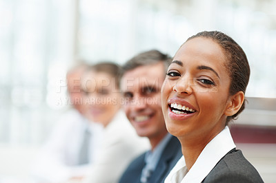 Buy stock photo Closeup image of a laughing African American business woman at a conference