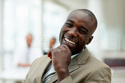 Buy stock photo A cheerful African American business man laughing with hand on the chin