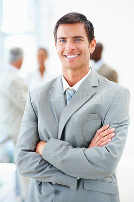 Buy stock photo Confident young business man with hands folded
