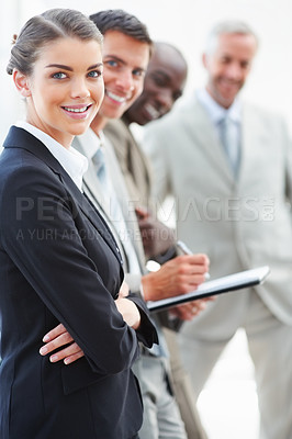 Buy stock photo A confident business woman standing with hands folded