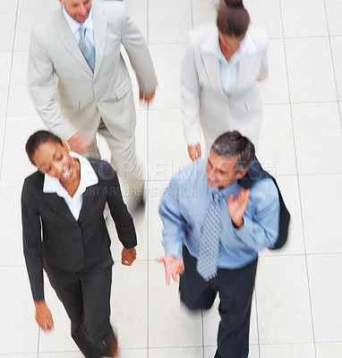 Buy stock photo Blurred motion view of business people walking together
