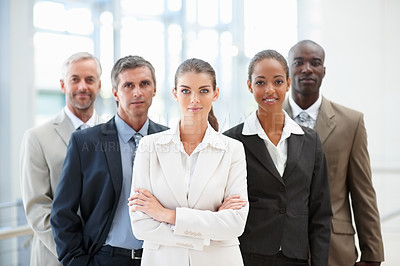 Buy stock photo Portrait of a group of business colleagues confidently standing together